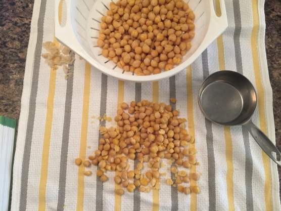 Chickpeas in the process of skinning